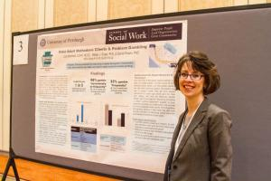 Jody Bechtold presents her research during the NCRG's poster session and reception.
